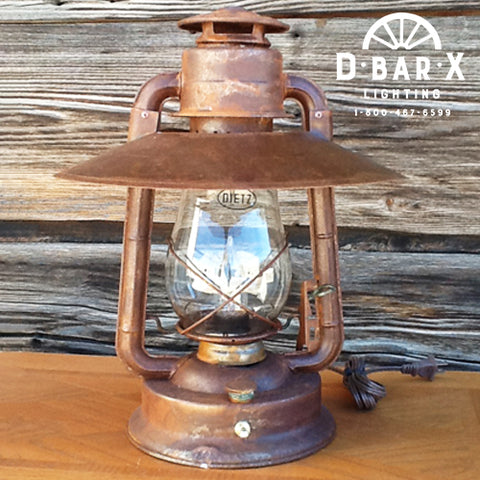 Photo of a rustic, old-fashioned Lantern Table Lamp with Reflector Shade.