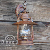 Image of D Bar X Lighting's rustic lantern wall sconce in Old-Fashioned Rust..