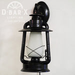 Image of D Bar X Lighting's rustic lantern wall sconce in Glossy Black..