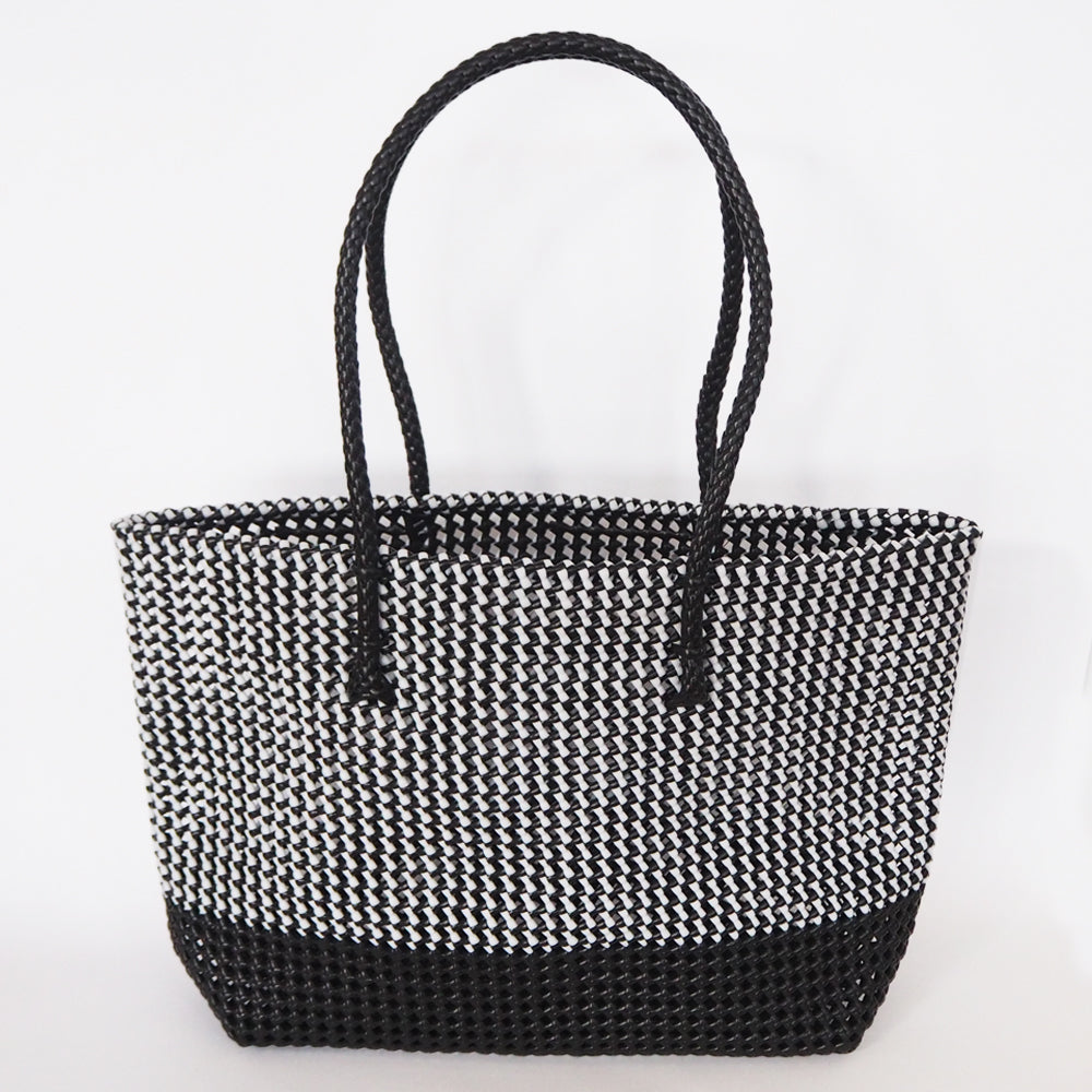 Fair trade market basket hand woven from recycled plastic