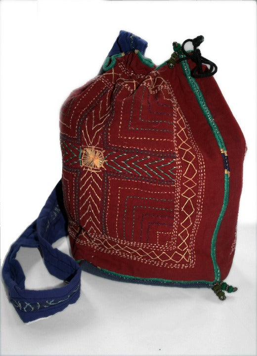 Hand embroidered drawstring bag from recycled textiles