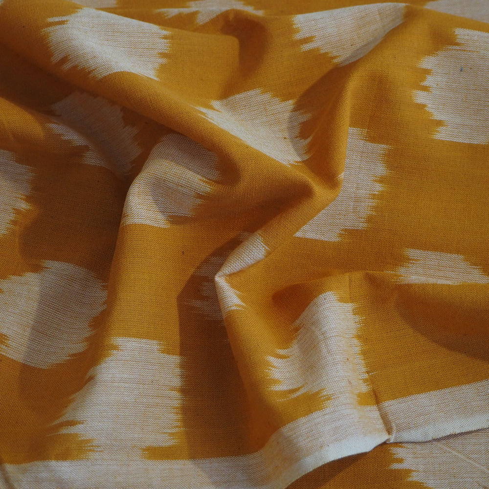 Hand woven Pochampally orange/white Ikat cotton fabric