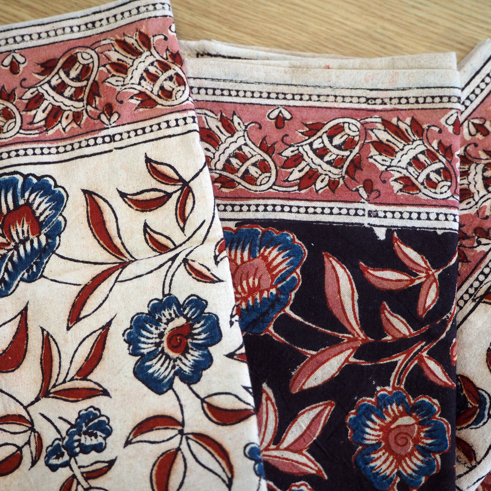 A set of four hand printed table napkins with natural dyes
