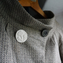 Load image into Gallery viewer, Dogtooth jacket with white porcelain brooch etched with buttercup design.