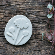 Load image into Gallery viewer, White porcelain brooch etched with buttercup design.