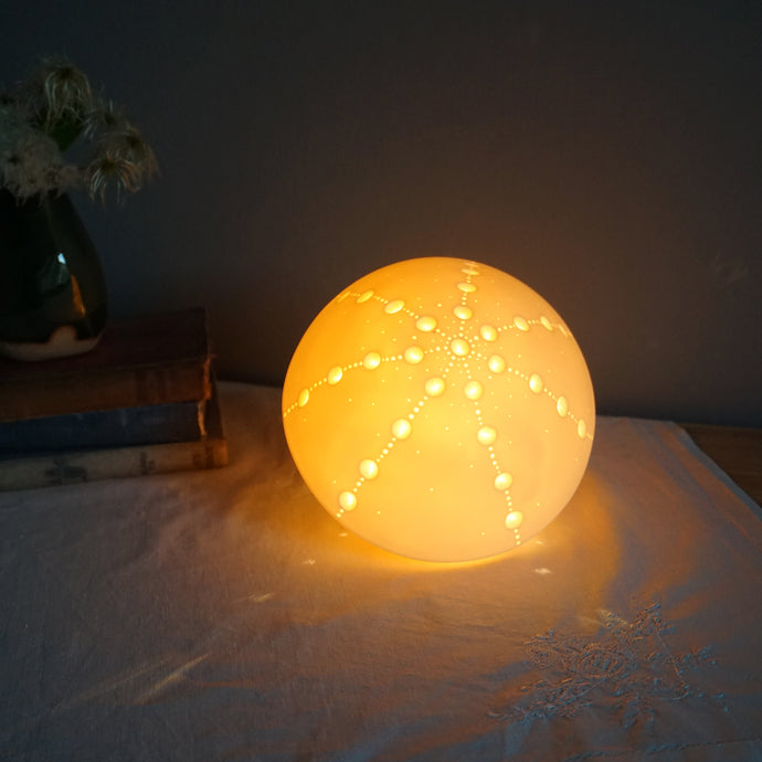 Glowing Sea Urchin Porcelain Lamp with starburst design made with indentations.