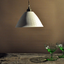 Load image into Gallery viewer, Pure white bell shaped lampshade with small dots running from top to bottom with braided cable. Two green glasses on the right.