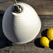 Load image into Gallery viewer, Pure white bell shaped lampshade with small dots running from top to bottom seen from above. Three lemons on the right.