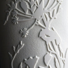 Load image into Gallery viewer, Detail of cylinder Lamp, pure white, etched design depicting tangled bindweed hedgerow in silhouette.
