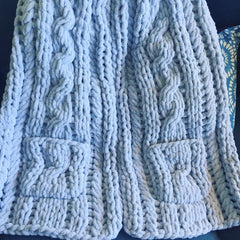 Grey chenille Celtic scarf with pockets.