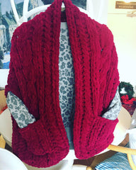 Red chenille Celtic shawl with pockets.