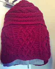 Red chenille Celtic shawl, seen from the back.