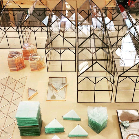 Hall house terrariums being constructed with stained glass techniques