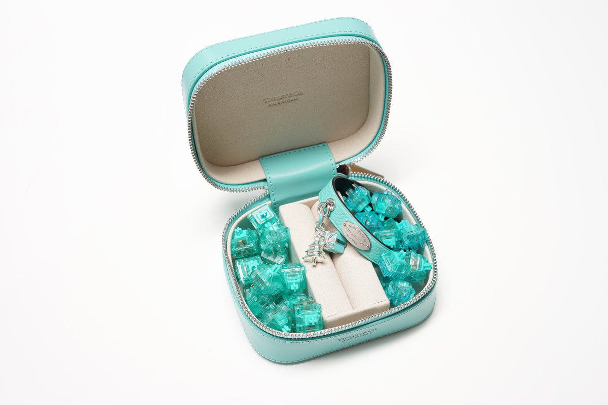 Tiffany blue ring box featuring Tiffany blue bracelet and charms with Tealios