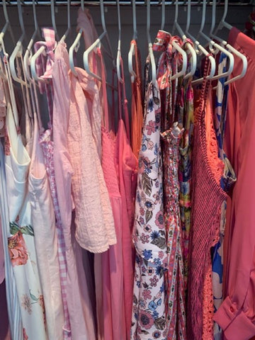 Colour coding helps with wardrobe de-cluttering. This is my line-up of pink Summer dresses