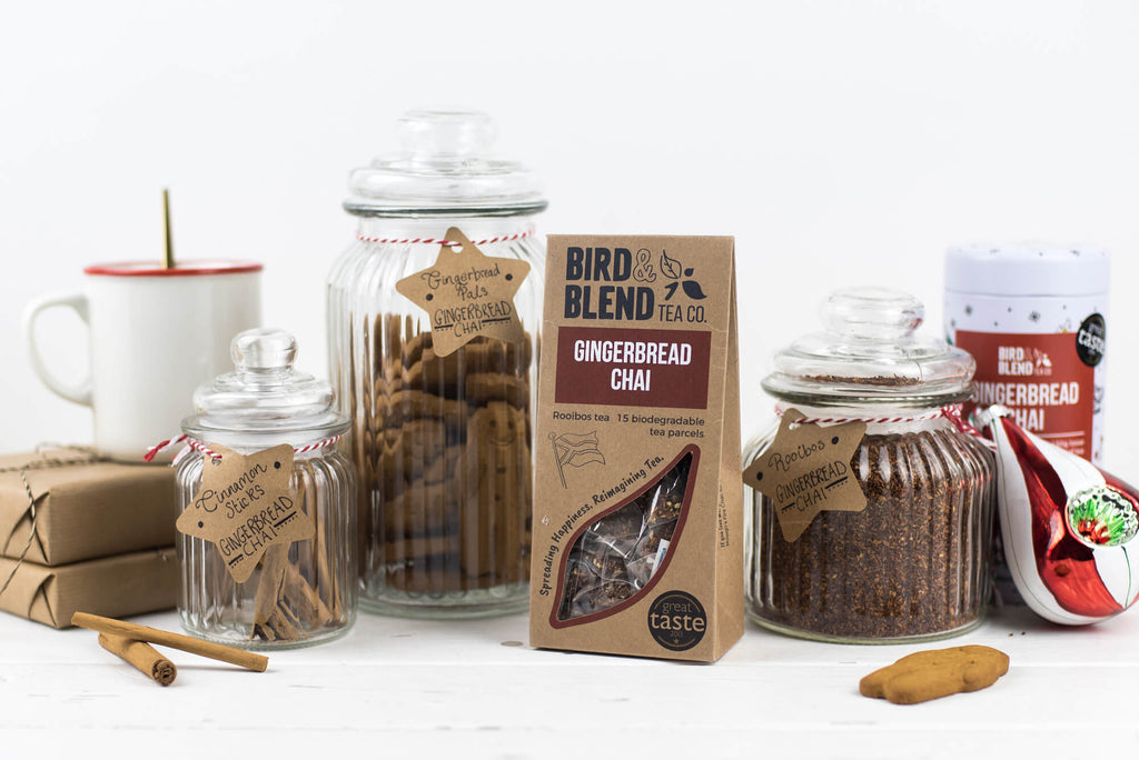 A packet of Gingerbread Chai tea and jars of gingerbread biscuits.
