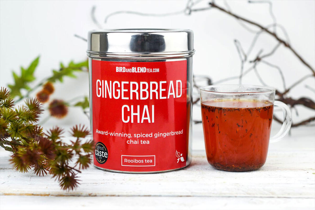 our award-winning gingerbread chai, tea tin with a cup of tea next to it