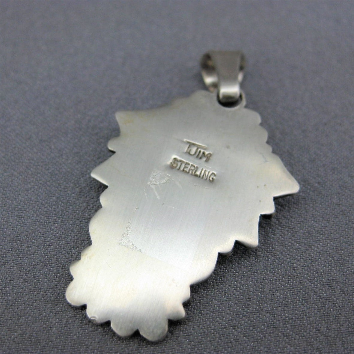Hand Stamped Silver Pendant by Thomas Jim