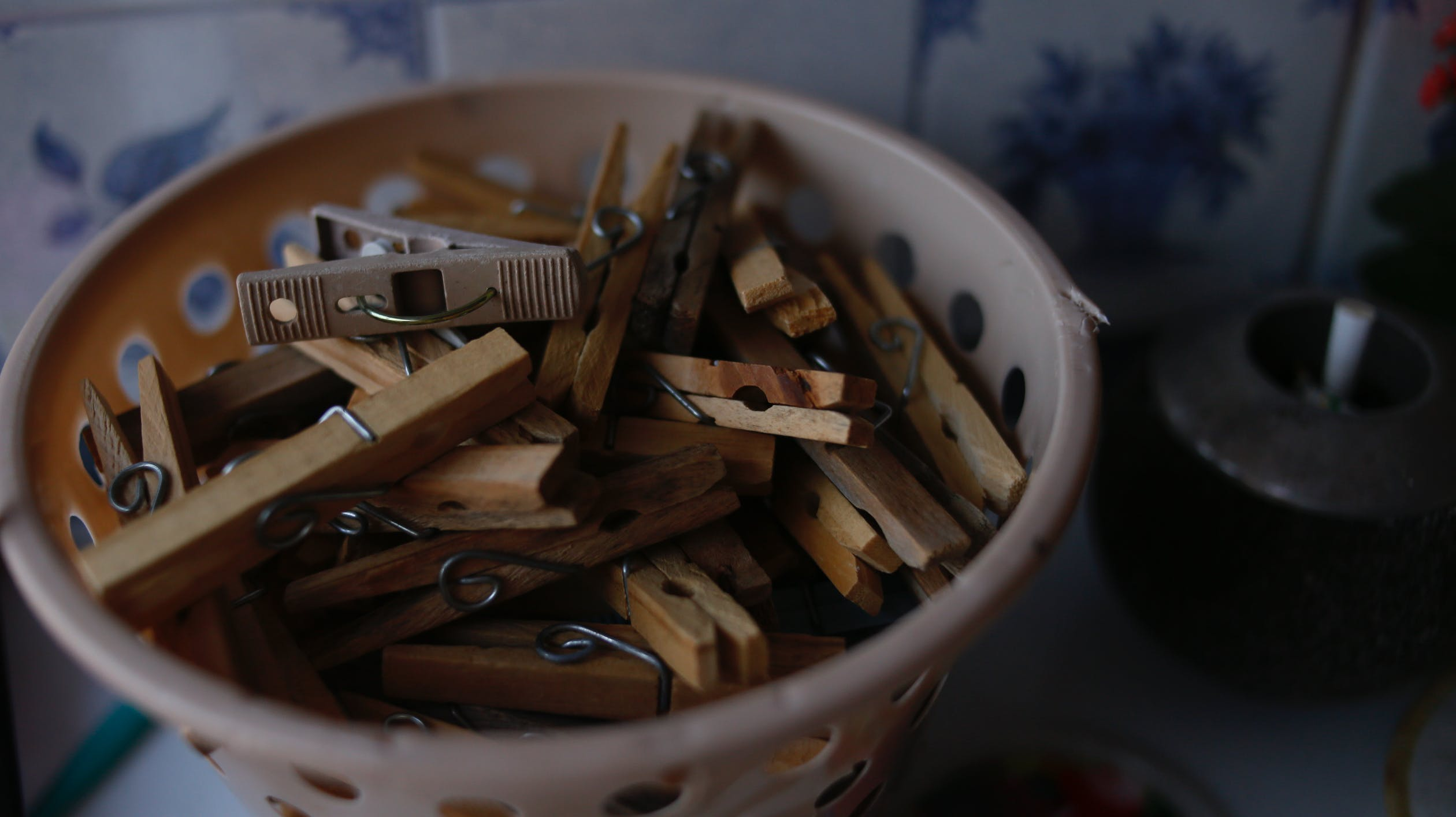 Basket of wooden clothes pegs