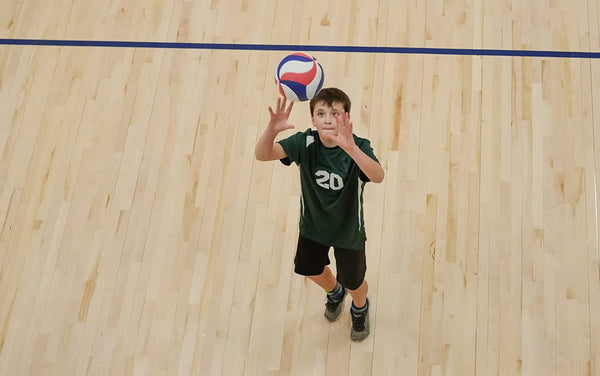 kid playing volleyball
