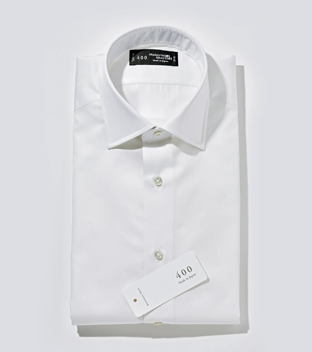 A brilliant white shirt made of a silky fabric