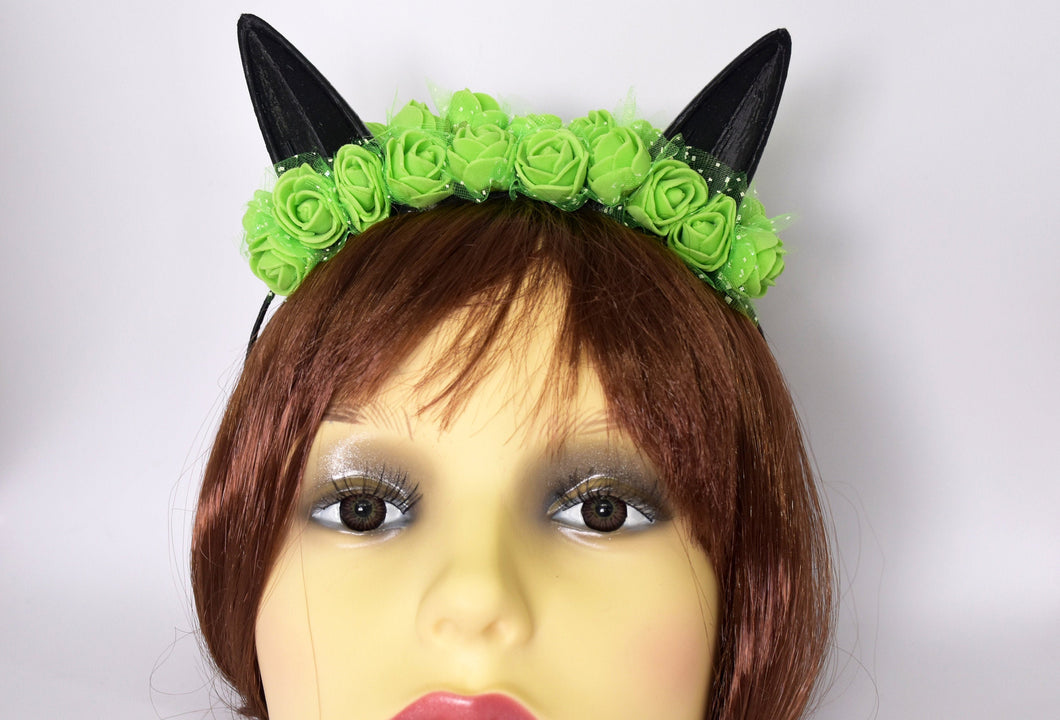 Cute cat ears with green flowers