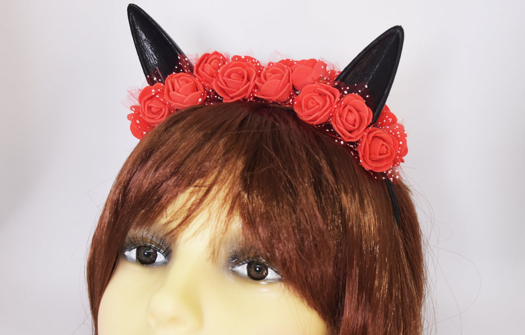 Cute cat ears with red flowers