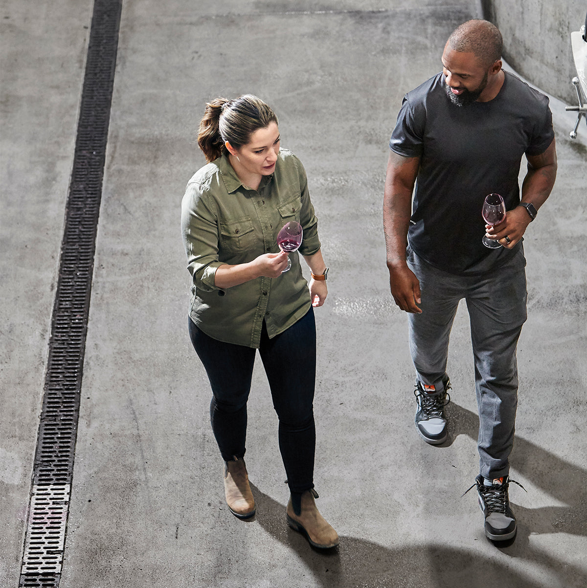 Intercept Winemaker Amanda Gorter and Charles Woodson walking through the winery. Photo by Christina Schmidhofer.