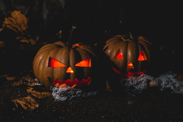 Two Halloween pumpkins with light