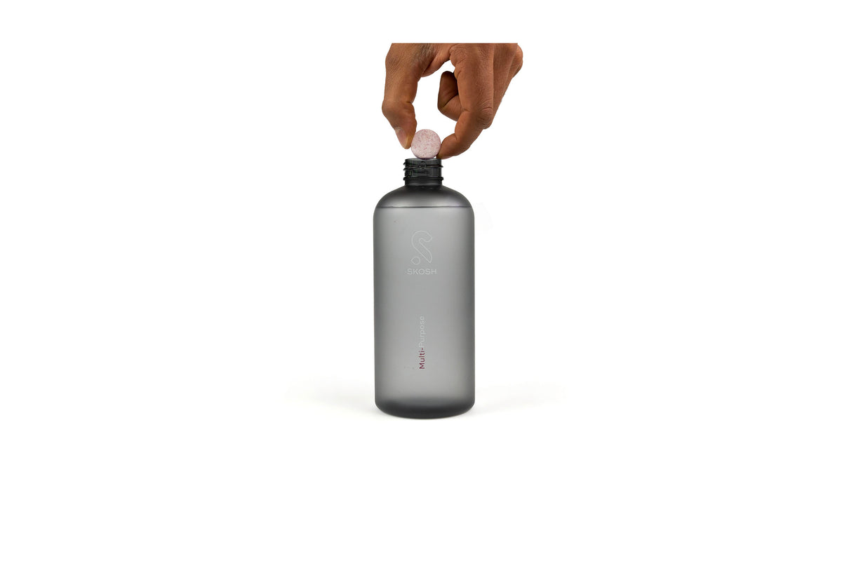 Drop the sustainable and eco-friendly surface cleaning tablet into the reusable bottle