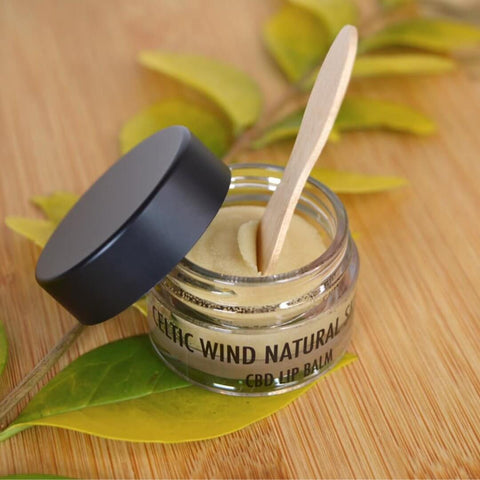 CBD Lip Balm on a table made by Celtic Wind