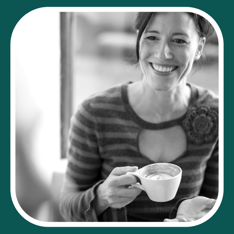 Healthy woman sitting drinking coffee and smiling