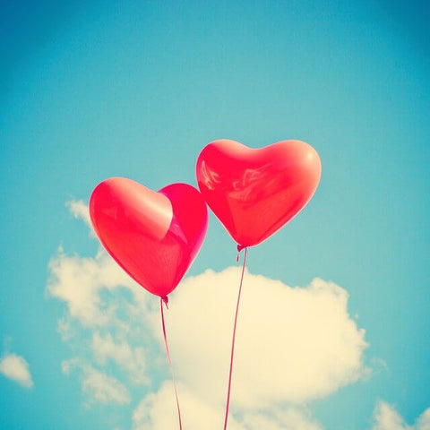 Two heart balloons representing the big love we send to our NHS Community Services