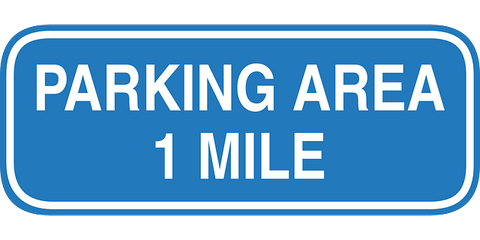 Hospital Car Parking can be an issue. Here we have a parking sign that states that the parking area is one mile away.