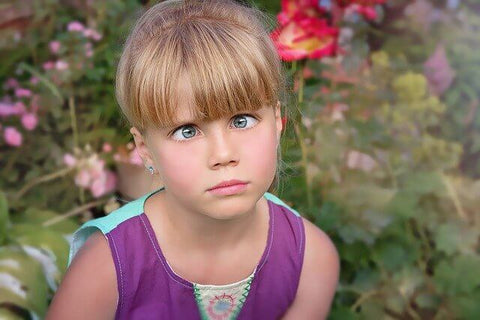 A confused looking little girl who's gone cross-eyed.