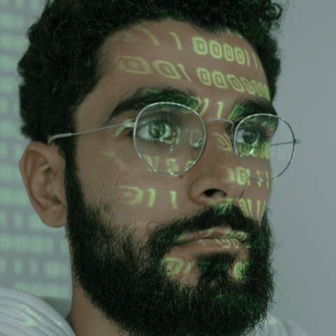 Man with digital text on face and glasses