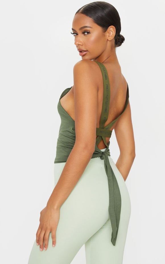 Prettylittlething Khaki Strappy Tie Back Gym Top - fashion.type.com