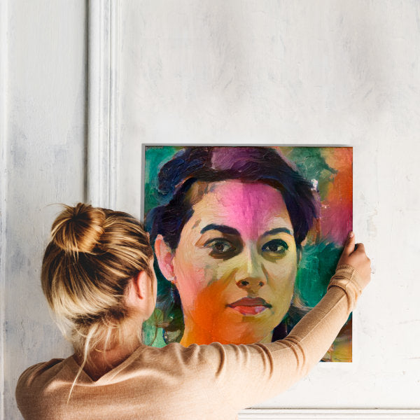 woman holding artwork