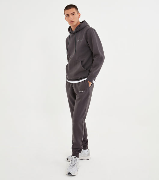 Coal joggers made from soft cotton mix featuring the NICCE logo on the left leg. A tapered fit, it has an elasticated waist with drawcord, side pockets and ankle cuffs. Wear with matching hood.