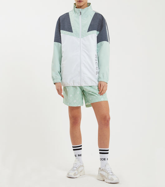 Avalo track jacket in a white, navy and mint reflective check. Featuring colour-block design, funnel collar, zip-fastening, branded taping, elasticated cuffs, reflective check panel and printed logo. Pair with joggers.