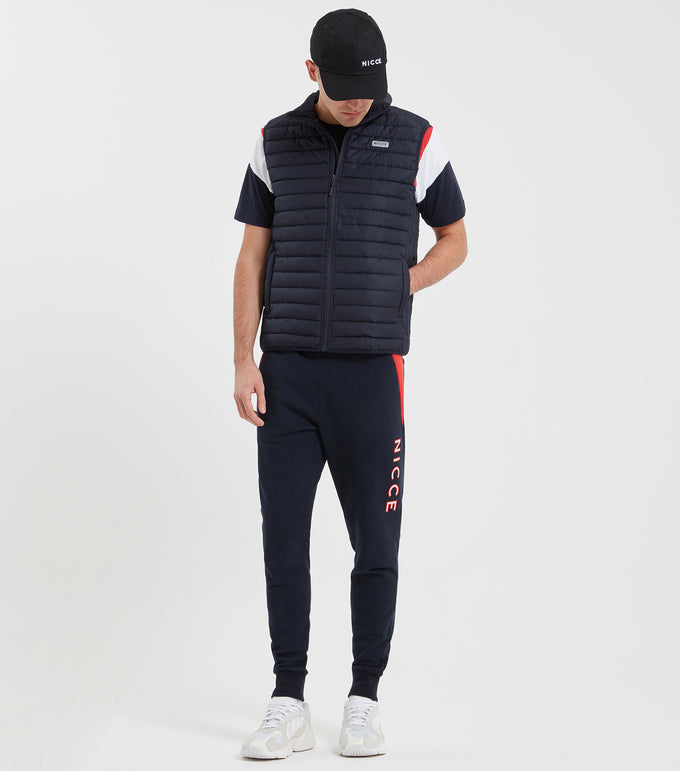Pathway gilet in navy. Features quilted design, funnel collar, zip fastening, functional pockets, regular fit, reflective front and rear branding. Pair with jogger and hood set.