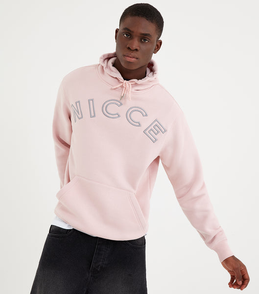 Bower hood in pink. Featuring relaxed fit, overhead hood and large front embroidery logo. Pair with joggers.