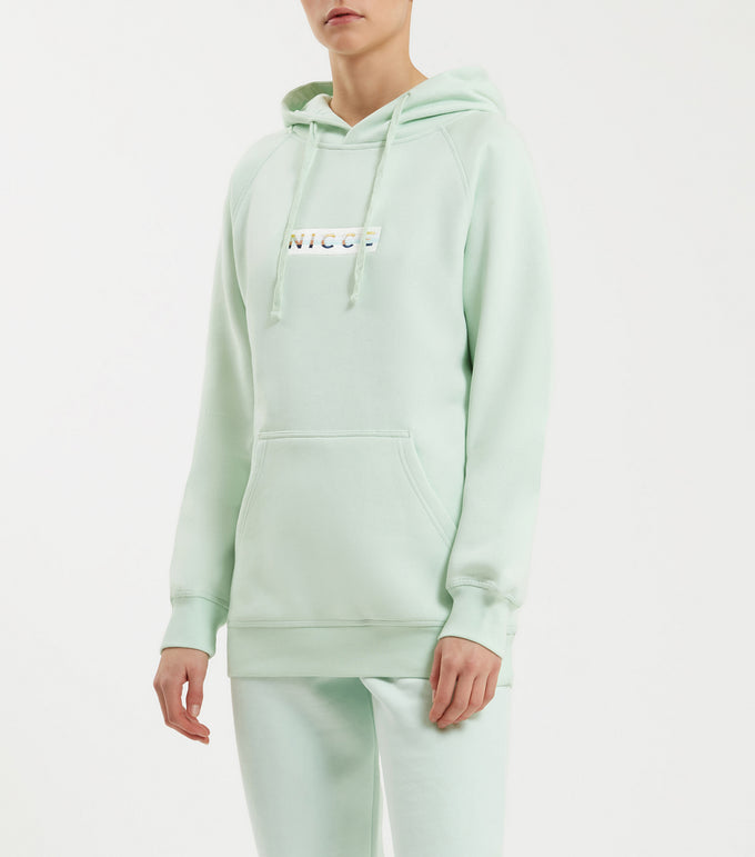 Hyam hood in mint. Featuring overhead hood, 90s style five colour box embroidered branding, front pounch and raglan sleeve. Pair with joggers.   This is a unisex product, size down for true women's sizing.