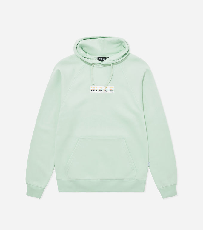 Hyam hood in mint. Featuring overhead hood, 90s style five colour box embroidered branding, front pouch pocket and raglan sleeve. Pair with joggers.