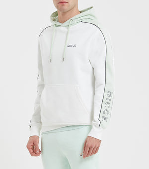 Border hood in off white and mint. Features relaxed fit hood with contrast panels, overhead hood and arm branding. Pair with mint joggers.