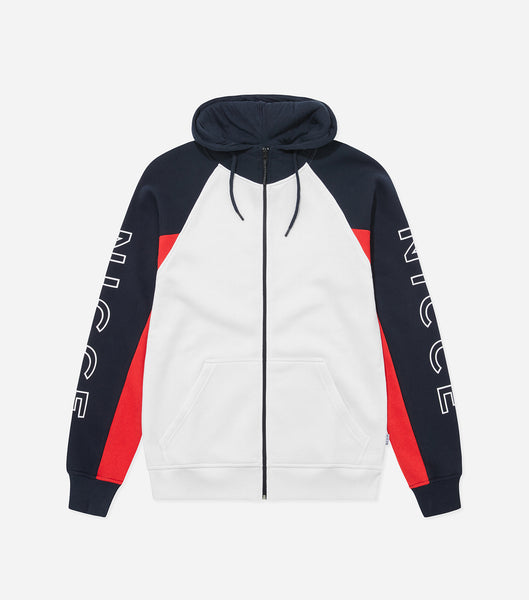 Stockton zip thru hood in white and deep navy. Features colour block design, zip through hood, front pocket, funnel neck and large arm branding. Pair with joggers.