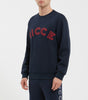Bower sweat in navy. Features crew neck, relaxed fit, large embroidered chest logo. Pair with joggers or denim.