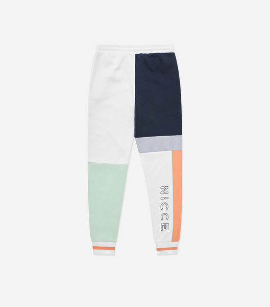 Limited Edition teria joggers in coral, deep navy and white. Features colour block design with large branding, tipped ribbing, pockets and elasticated waistband.  Pair with matching jacket.