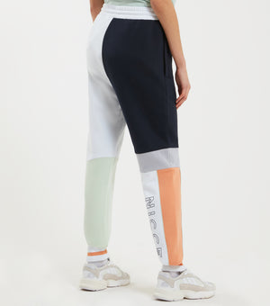 Limited Edition teria joggers in coral, deep navy and white. Features colour block design with large branding, tipped ribbing, pockets and elasticated waistband.  This is a unisex product, size down for true women's sizing.