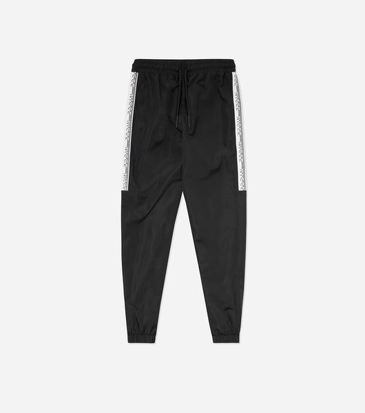 Byron tapered track pants in black. Featured taped fit, elasticated waistband, pockets and printed logo. Pair with hood or tee.